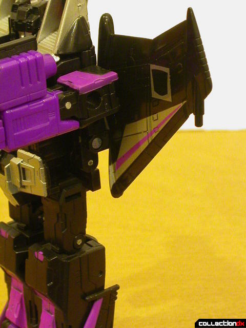 Decepticon Skywarp- robot mode  missile launcher detail (arm forward, but launcher is held)