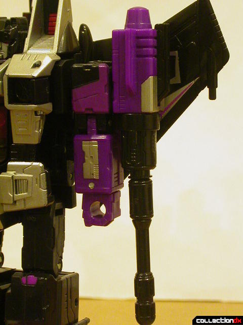 Decepticon Skywarp- robot mode (left arm, missile launcher on shoulder)