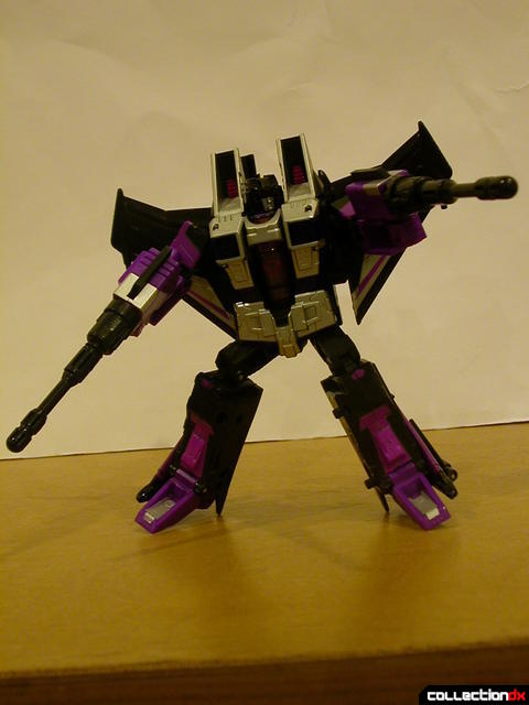 Decepticon Skywarp- robot mode posed holding missile launchers (2)