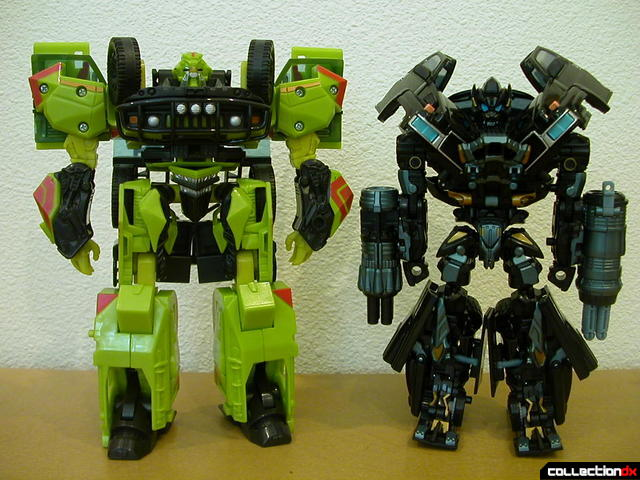 Voyager-class  Ratchet (right, original) and Ironhide (left, Premium repaint) in robot modes