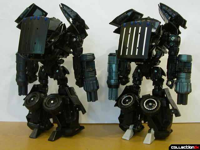 Voyager-class Ironhide- original release (left) and Premium repaint (right) in robot mode (back)