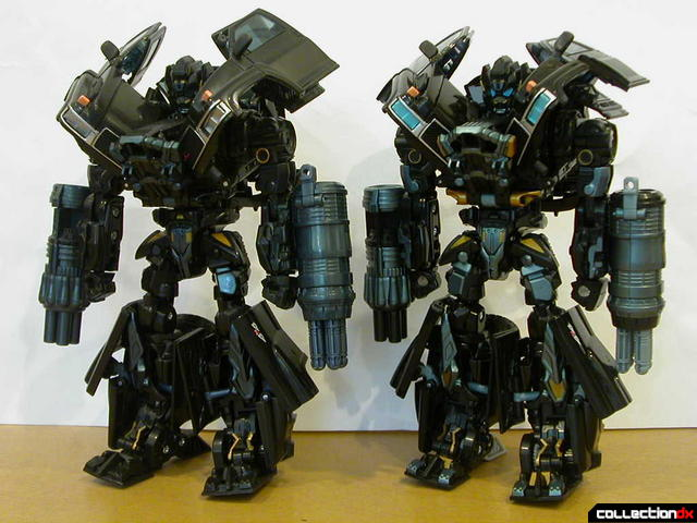 Voyager-class Ironhide- original release (left) and Premium repaint (right) in robot mode (front)