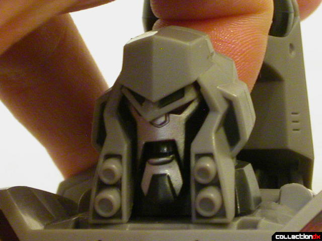 Decepticon Megatron- robot mode (carefully pushing up on head to move face)