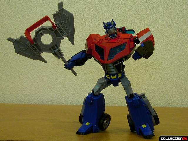 Autobot Optimus Prime- robot mode posed with Ion Ax (1)