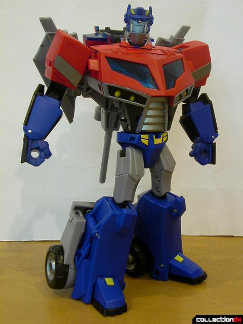 Autobot Optimus Prime- robot mode posed with Ion Ax and Water Cannon on back