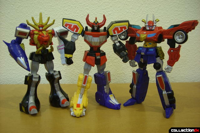 Retrofire Wild Force (L), Mighty Morphin' (C), and High Octane (R) Megazords posed