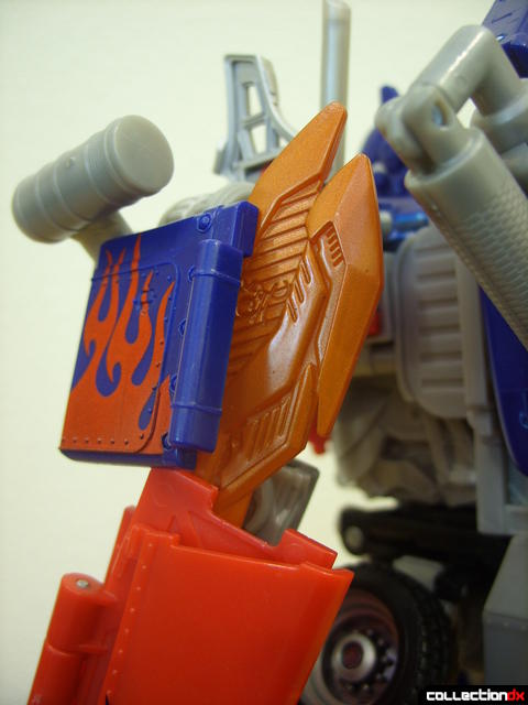 Leader-class Autobot Optimus Prime- robot mode (left sword wedged between blue plate)