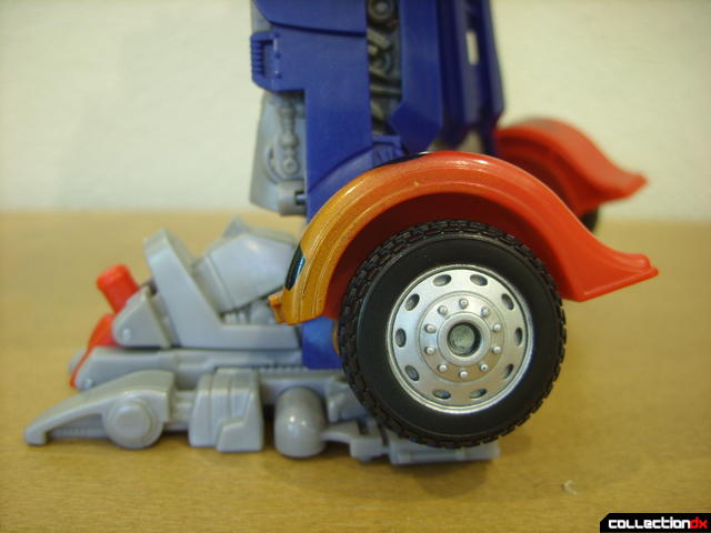 Leader-class Autobot Optimus Prime- robot mode (wheel detail along left ankle)