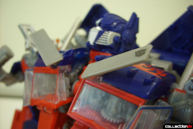 Leader-class Autobot Optimus Prime- robot mode posed (transforming upper body)
