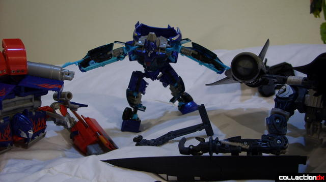 Autobot Jolt (C) combines Optimus Prime (L) with Jetfire (R)