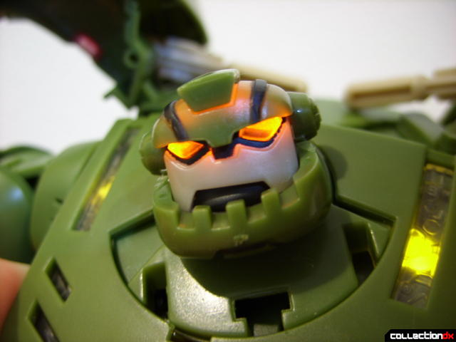 Animated Leader-class Autobot Bulkhead- robot mode (head turned, lights on)