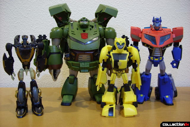 L-to-R- Autobots Prowl, Bulkhead, Bumblebee, and Optimus Prime