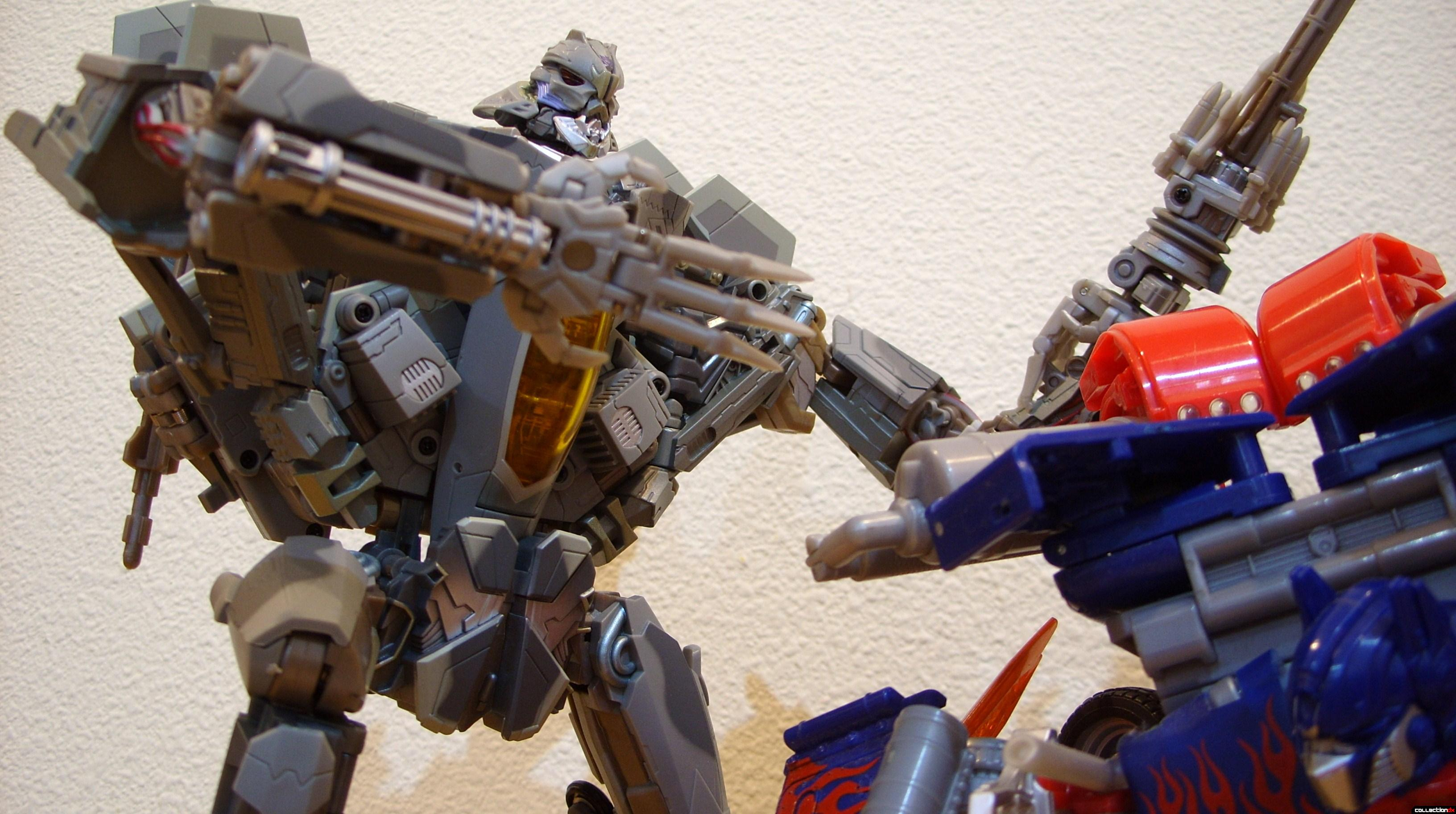 Masterpeice Movie Series Starscream- Robot Mode (L) posed with Leader-class Optimus Prime (R)
