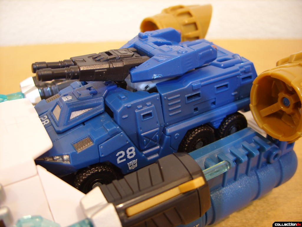 Voyager-class Autobot Sea Spray- vehicle mode (ramp, holding Scout-class Autobot Breacher)