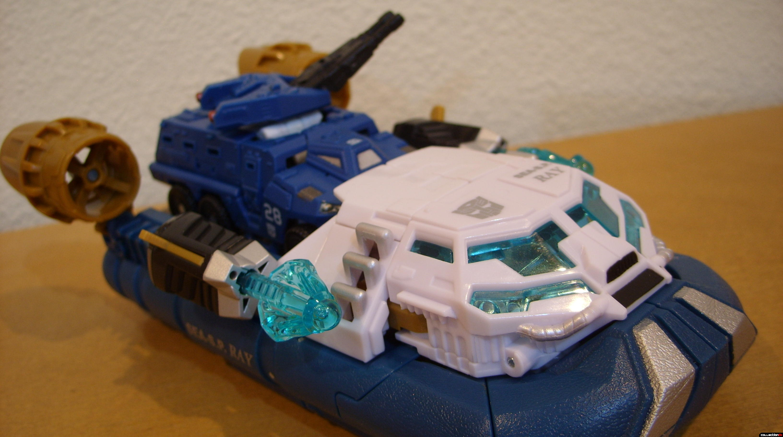 Voyager-class Autobot Sea Spray- vehicle mode dramatic angle (with Scout-class Autobot Breacher)