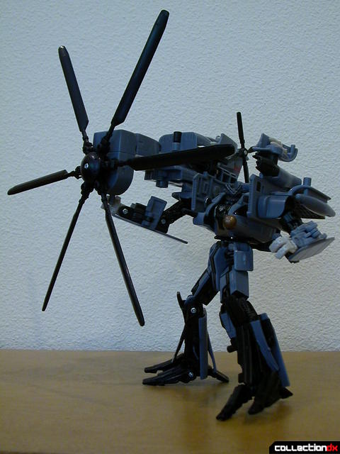 Decepticon Blackout- robot mode (posed with rotor weapon)