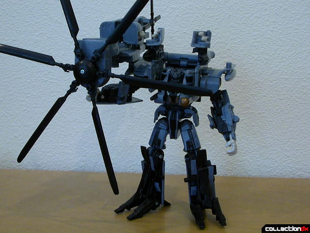 Decepticon Blackout- robot mode (with rotor weapon attached)