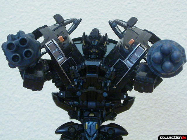 Autobot Ironhide- robot mode (pointing cannons)