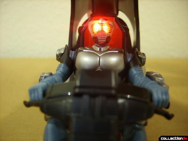 Kamen Rider Blank Knight with Advent Cycle (figure seated, eyes glowing)