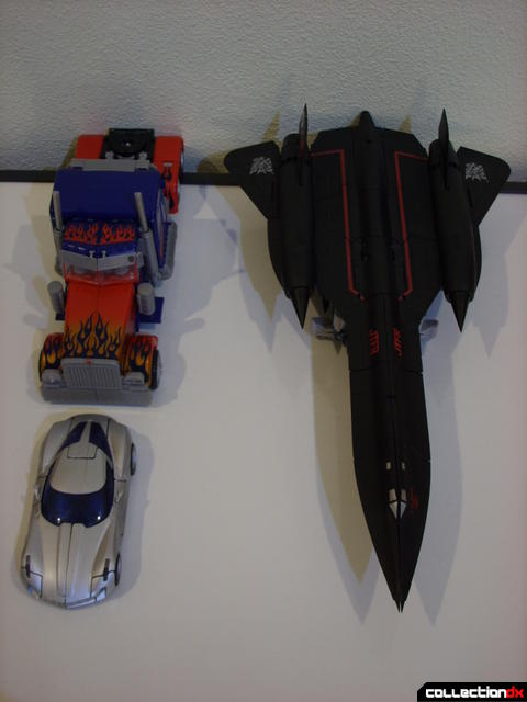 RotF Leader-class Autobot Jetfire (R), Optimus Prime (L, back), and Deluxe-class Sideswipe (L, front) vehicle modes