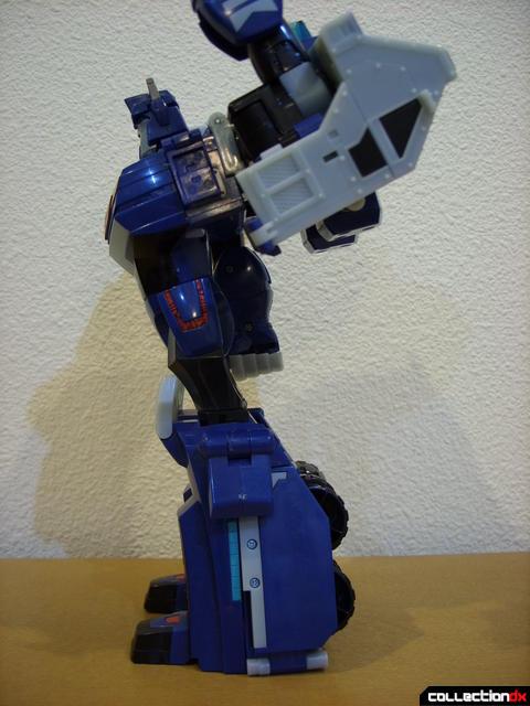 Animated Leader-class Autobot Ultra Magnus- robot mode (posture detail, left arm raised vertically)
