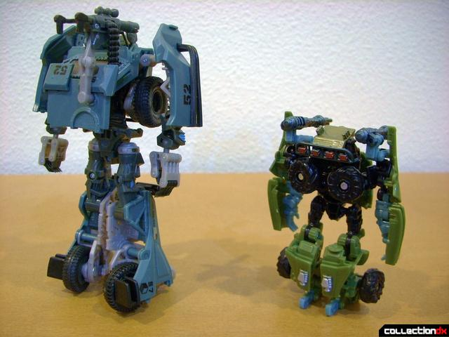 Scout-class Dune Runner (R) and Deluxe-class Landmine (L) in robot mode (back)